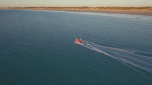 Boat Hire boat cruising off Cable Beach, Broome, West Australia.