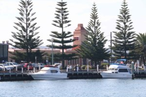 Boats moored opposite the Lakes Entrance Hotel, Lakes Entrance, Victoria