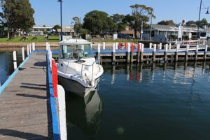 Boat moored opposite the Metung Hotel, Gippsland Lakes, Victoria