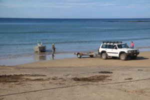 Boat retrieval at the Point Roadnight boat ramp, Anglesea Victoria