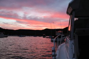 Sunset over boats moored in Sandbrook Inlet, Hawkesbury River, NSW